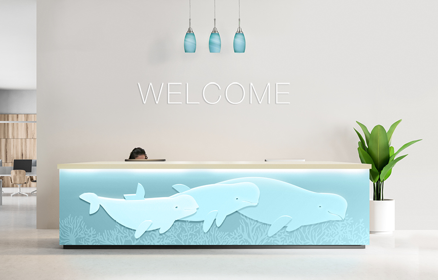 Reception/Front desk for an aquarium fitted with custom minimalist beluga whale sculptures
