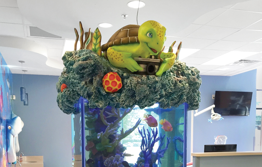 Custom aquarium decor of a cute turtle on top of 3d foam coral