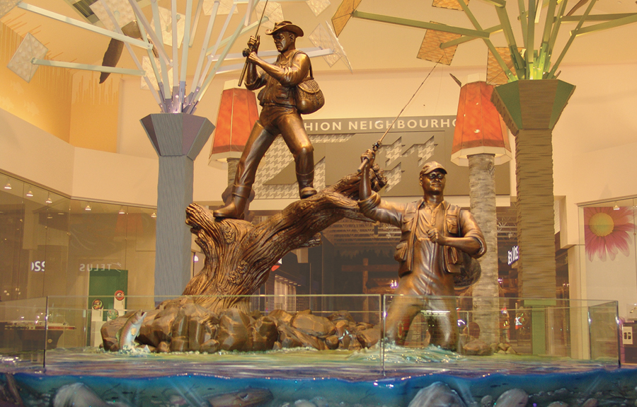 Custom bronze sculptures of fishermen in a mall's public art display