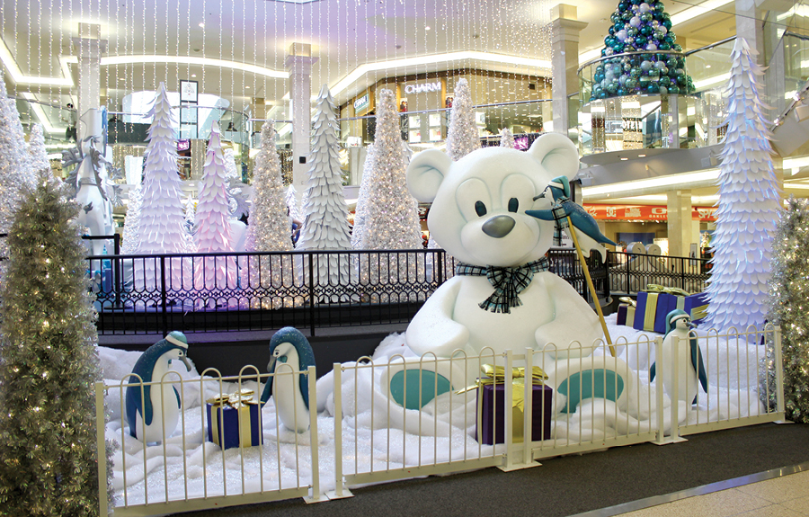 Mall display with custom christmas décor of penguins and teddy bears