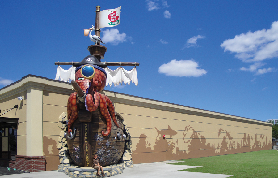 Pirate octopus character with pirate ship as an office exterior landmark