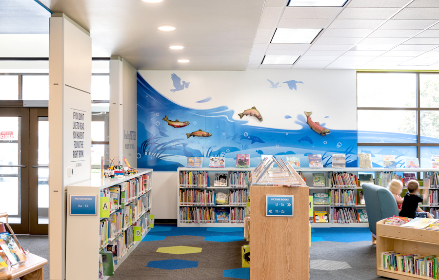 Library decorated with stylish wall river mural and sculptures of fish
