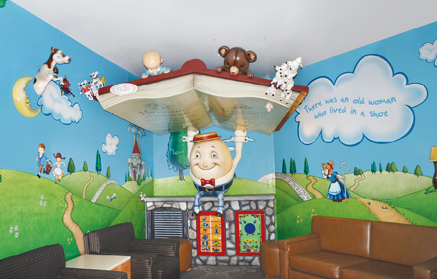 Library and play area with nursery rhyme characters and theming