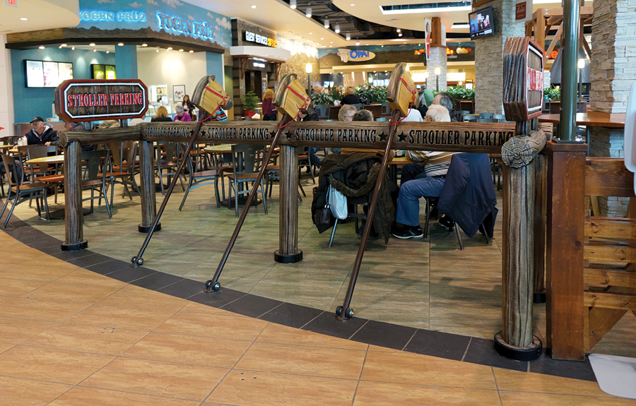 A western themed stroller parking area in a mall