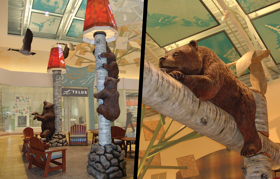 Mall seating area with nature themed décor featuring sculpted bears, trees and flying geese
