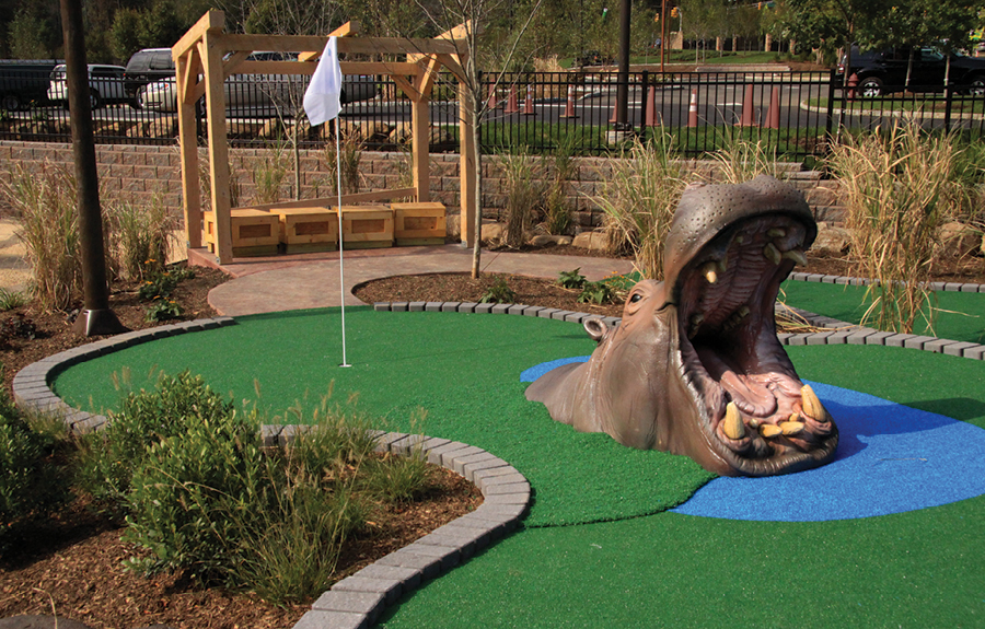 Mini golf course decorated with a realistic foam hippo