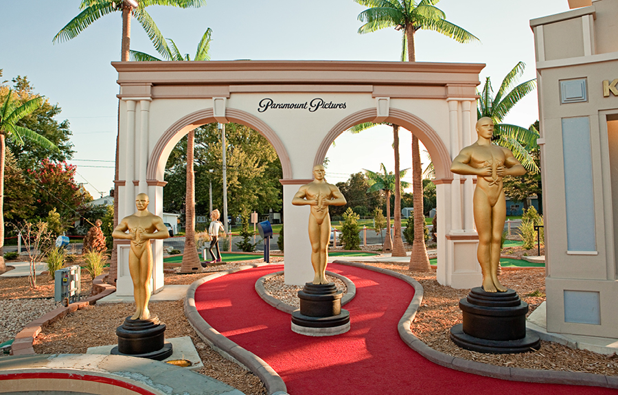 Giant foam academy award trophies in a movie themed mini golf course