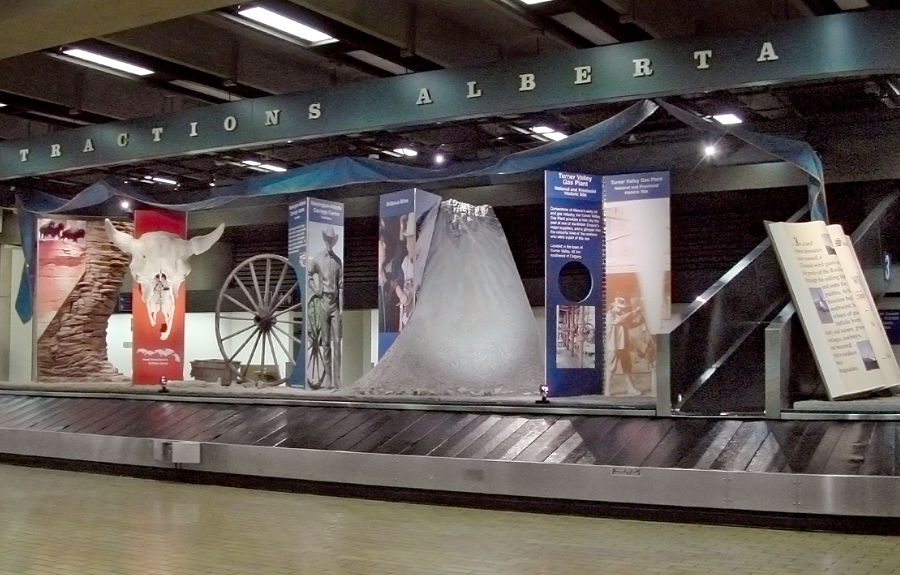 Western themed sculpted foam displays in an airport exhibit about the history of Alberta