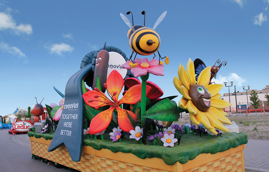 Flower basket themed parade float with custom designed foam flowers and bugs made for Cenovus