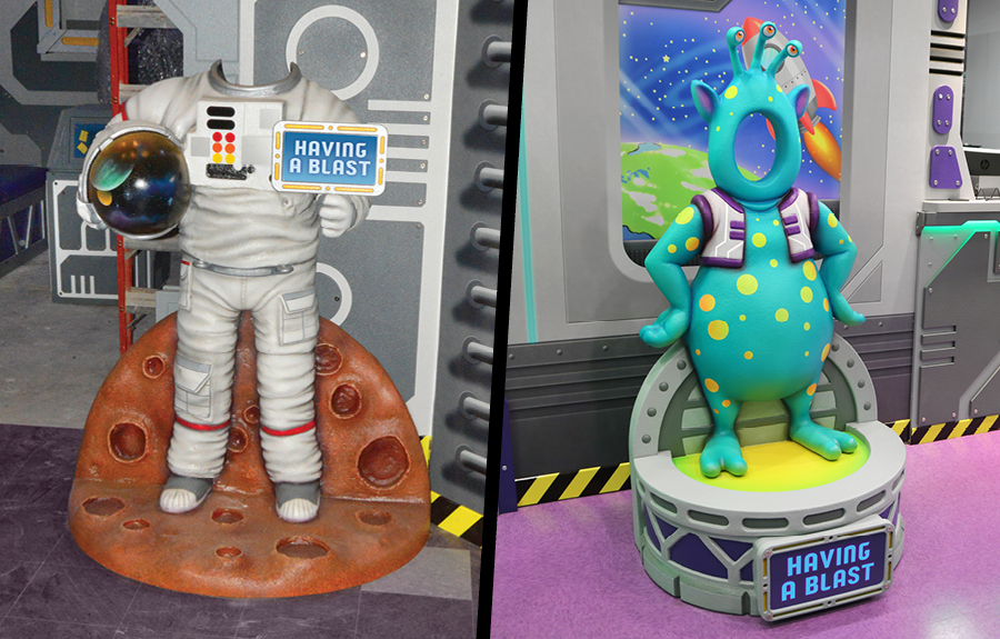 3D sculpted photo op cut outs designed like an astronaut suit and a colorful alien