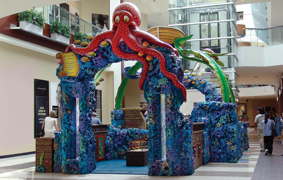 Kids play area in mall with colorful underwater theming, 3D foam animals and coral walls