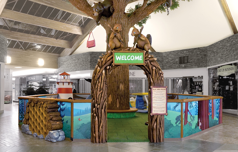 Mall play area with a custom sculpted enclosure, forest animals, and woodland theming