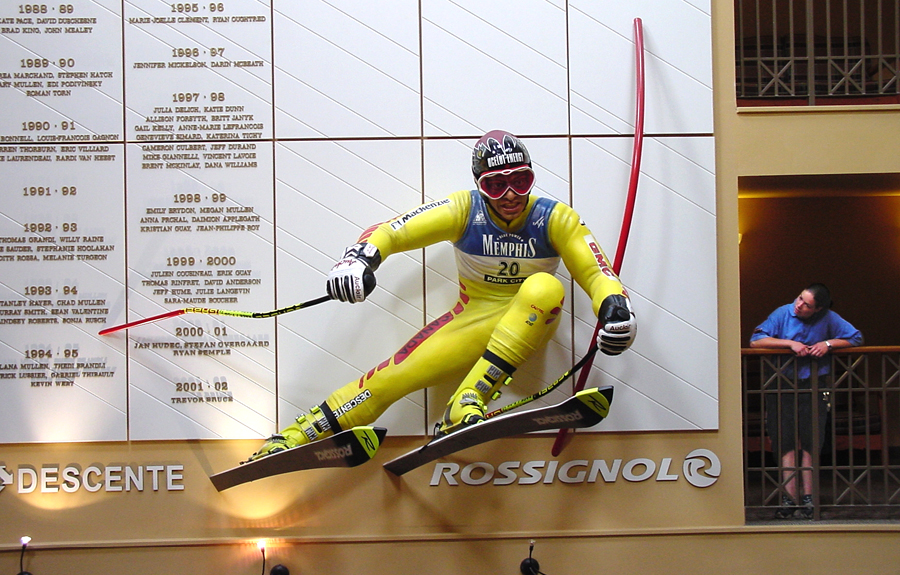 Oversized realistic 3D foam sculpture of a slalom skier in a sports history museum