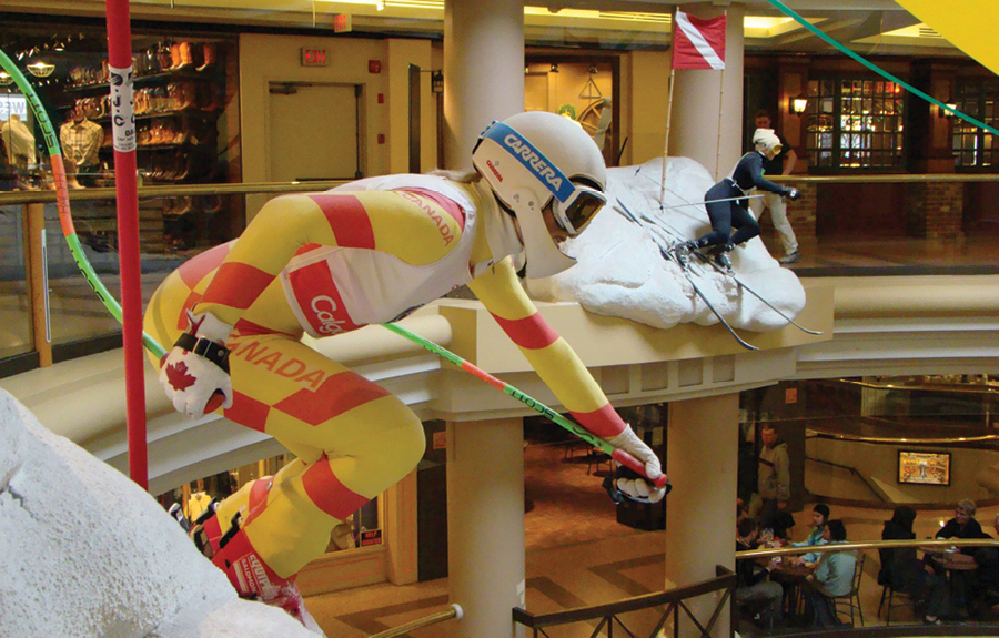 Sculpted displays of olympic downhill skiers in mall