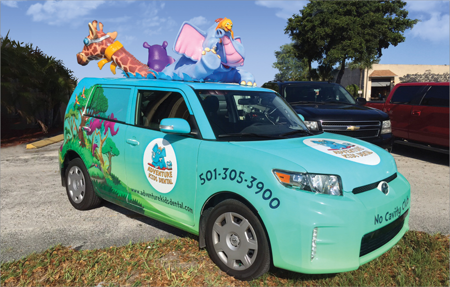 Vinyl vehicle wrap with custom promotional art and sculpted roof animal mascots