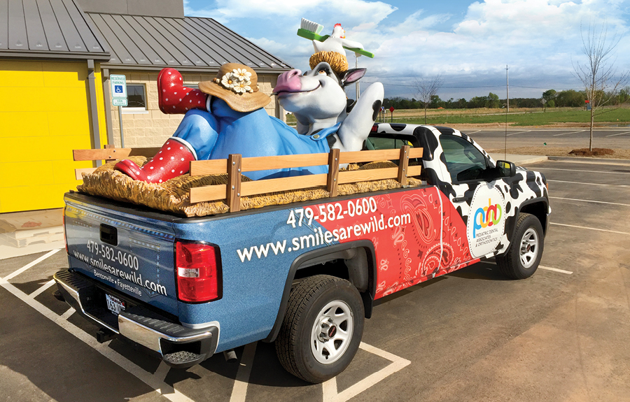 Custom promotional truck wrap with a sculpted cow mascot