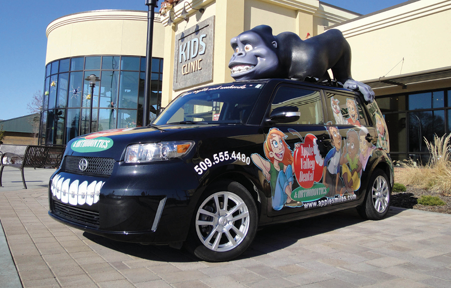 Promotional vehicle wrap with custom designed graphics and 3D foam mascot