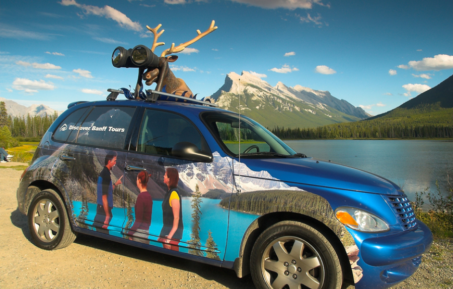 Vehicle wrap with a custom made roof mascot for a Banff mountain tourism company