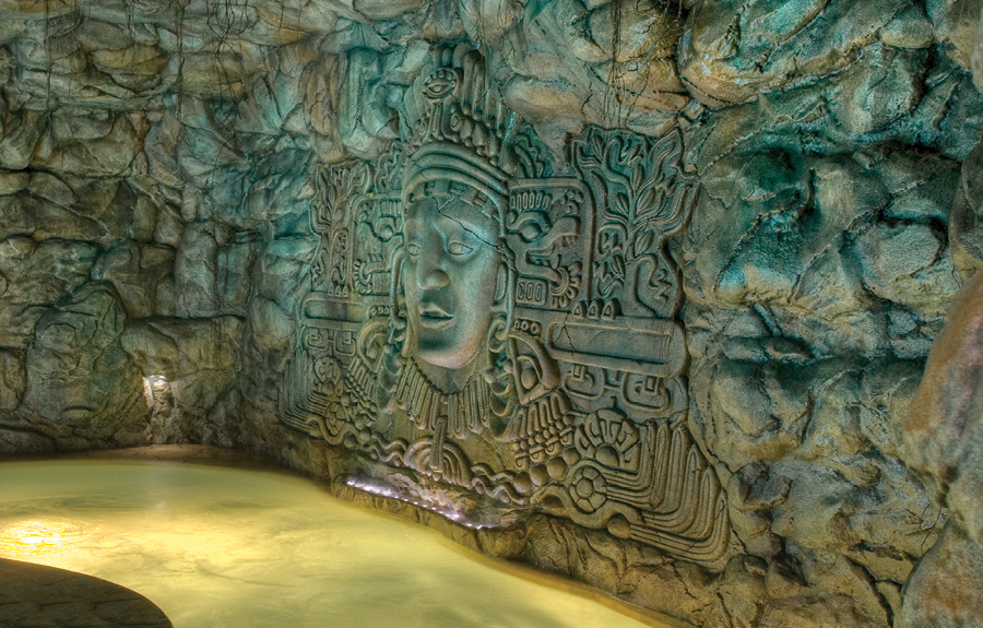 Aztec themed waterpark attraction with sculpted reliefs and stone wall cladding