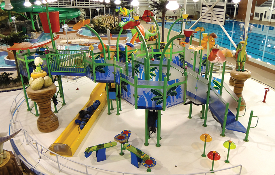 Overhead view of a dinosaur themed water park filled with foam sculptures and play structures
