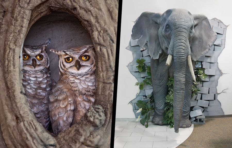 Foam sculptures of owls in a tree hole and an elephant busting out of a wall